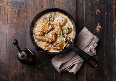 Roasted chicken with creamy garlic sauce Stock Photography