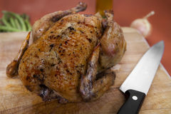 Roasted Chicken on Cutting Board Royalty Free Stock Photography