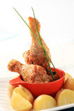 Roasted chicken drumsticks stock images