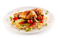 Roasted chicken drumsticks. Boiled white rice and vegetables royalty free stock photography