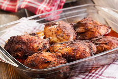 Roasted chicken drumsticks in casserole dish Royalty Free Stock Photo