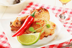 Roasted chicken drumsticks Stock Photos