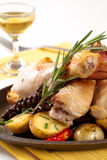 Roasted chicken drumsticks and potatoes Royalty Free Stock Photo