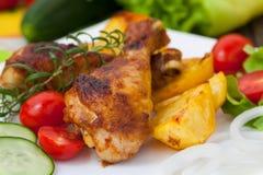 Roasted chicken drumsticks s Stock Photo