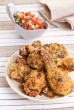 Roasted chicken drumsticks with salsa Royalty Free Stock Photo