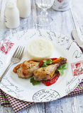 Roasted chicken drumsticks with sweet pepper royalty free stock photos