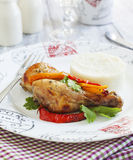 Roasted chicken drumsticks with sweet pepper Royalty Free Stock Images