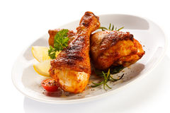 Roasted chicken drumsticks on white background Royalty Free Stock Photo