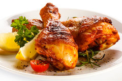 Roasted chicken drumsticks on white background Royalty Free Stock Images