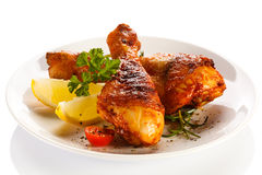 Roasted chicken drumsticks on white background Stock Photography