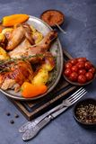 Roasted chicken with fork and knife Royalty Free Stock Images