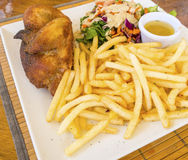 Roasted Chicken with French Fries Royalty Free Stock Images