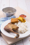 Roasted chicken with fried tofu, tempeh, chilli sauce, and white rice Royalty Free Stock Photos