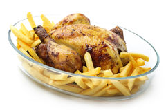 Roasted chicken with fries Stock Photo