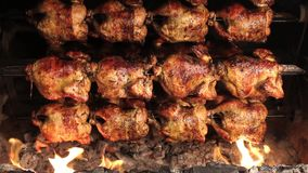 Roasted chicken grilled on fire, barbeque. In South America called pollo a la brasa. stock footage