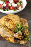 Roasted Chicken with Herbs and Greek Salad Stock Photo