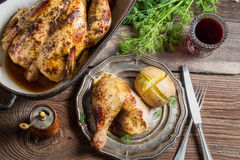 Roasted chicken and jacket potato served with wine Royalty Free Stock Images
