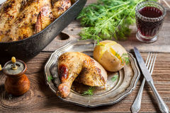 Roasted chicken and jacket potato served with wine Stock Photography