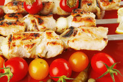 Roasted chicken kebab on red royalty free stock image