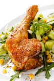 Roasted chicken leg. And vegetables stock photo