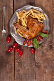 Roasted chicken leg. Royalty Free Stock Photo