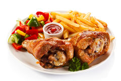 Roasted chicken leg. French fries and vegetables royalty free stock photos