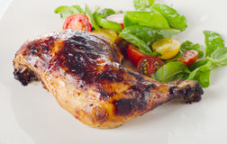 Roasted chicken leg with fresh salad. Royalty Free Stock Photography