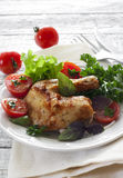 Roasted chicken leg with herbs and salad Stock Photography