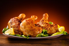 Roasted chicken leg. S and vegetables stock image