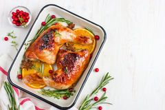 Roasted chicken leg with orange and spicy herbs Stock Image