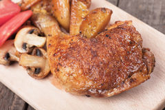 Roasted chicken leg. With oven baked poatoes, classic of traditional cuisine Royalty Free Stock Image