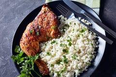 Roasted Chicken Leg Quarter with Cauliflower rice royalty free stock image