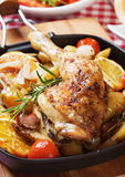 Roasted chicken leg with vegetables Royalty Free Stock Image