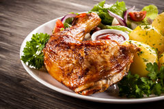 Roasted chicken leg Stock Images