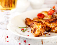 Roasted Chicken Legs And A Glass Of Beer Stock Photo