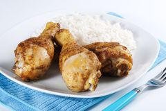 Roasted chicken legs with boiled rice Stock Photos