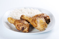 Roasted chicken legs with boiled rice Royalty Free Stock Photography
