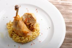 Roasted chicken legs with cooked Saffron rice Royalty Free Stock Images