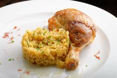 Roasted chicken legs with cooked Saffron rice Royalty Free Stock Image