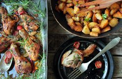 Roasted chicken legs and fried potatoes Stock Photo