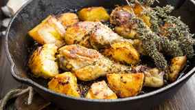 Roasted chicken legs with herbs and baked potatoes granish Stock Photo