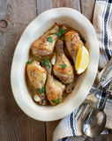 Roasted chicken legs with lemon and garlic Royalty Free Stock Photos
