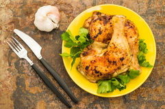 Roasted chicken legs on a old background. Top View. Close-up Royalty Free Stock Image