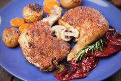 Roasted chicken legs. With oven baked poatoes, classic of traditional cuisine Royalty Free Stock Images