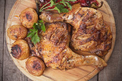 Roasted chicken legs. With oven baked poatoes, classic of traditional cuisine Stock Photography