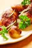 Roasted chicken legs on a plate Royalty Free Stock Images