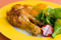 Roasted chicken legs with pota royalty free stock photos