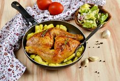 Roasted chicken legs with potatoes Royalty Free Stock Image