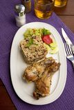 Roasted chicken legs with rice. Roasted chicken legs eith rice and mushrooms Royalty Free Stock Photo
