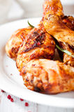Roasted chicken legs with rosemary and pnk pepper Royalty Free Stock Photos